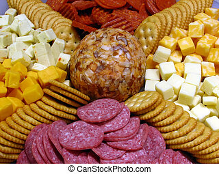 Cheese Tray - Closeup of a cheese tray with salt crackers, ...