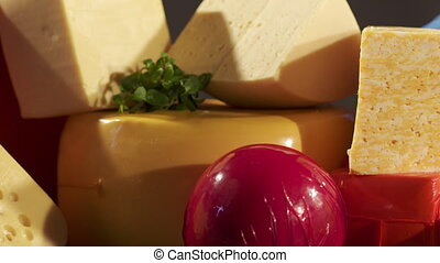 Cheese varieties. Different types of cheeses on wooden...
