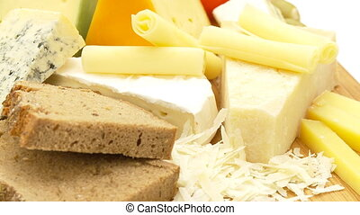 cheese very close - different cheese, bread, grapes and...