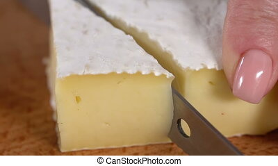 Cheese with mold cut with a knife. slow motion
