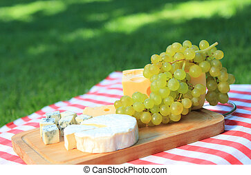 Cheese with white grapes