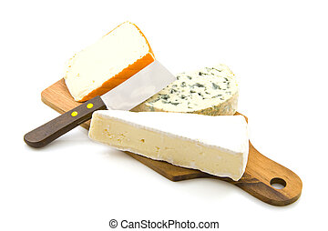 Cheeseboard - Different kind of cheese on wood isolated over...