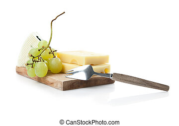 cheeseboard of hard and blue cheese with grapes