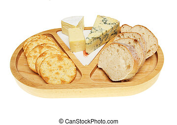 Cheeseboard with bicuits and bread isolated against white