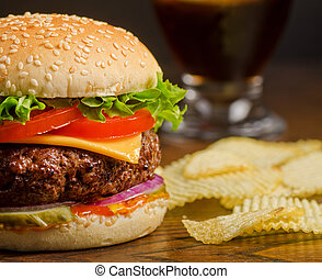 Cheeseburger and Chips - A deluxe cheeseburger with potato...