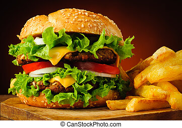 Cheeseburger and french fries - closeup of traditional ...