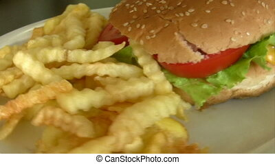 Cheeseburger and French fries with mustard