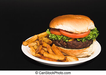 Cheeseburger and Fries - A delicious cheeseburger and an...