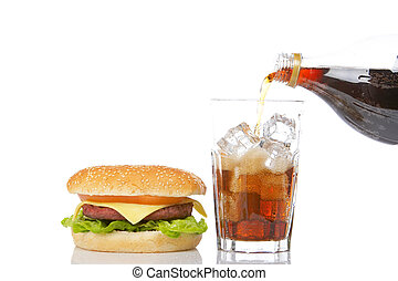 Cheeseburger and pouring soda
