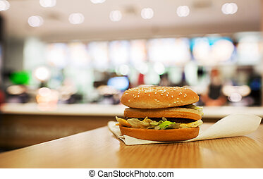 cheeseburger on the table. fast food restaurants.
