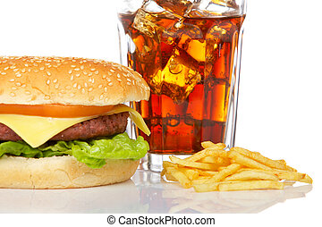Cheeseburger, soda drink and french fries, reflected on white background. Shallow DOF