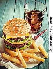 Cheeseburger, soda and French fries