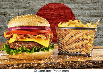 Cheeseburger with bacon and a basket of french fries. Japan flag's on brick wall in background.