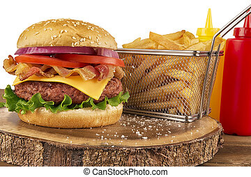 Cheeseburger with beef patty and bacon. French fries in basket, ketchup and mustard bottle. Isolated on white background.