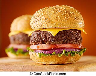 cheeseburgers on wooden board.