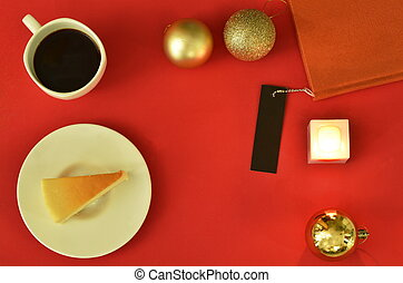 cheesecake and black coffe cup with decoration object for Christmas holiday on red background