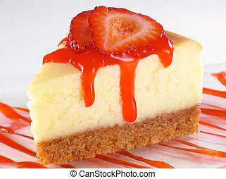 Cheesecake and Strawberry Sauce - Cheesecake with sliced...