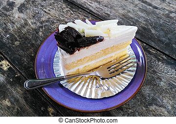 Cheesecake on a plate with spoon