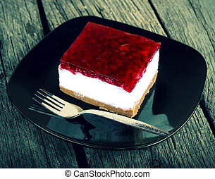 Cheesecake on old wood table