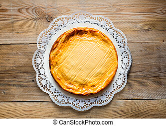 Cheesecake on rustic wood cake top.