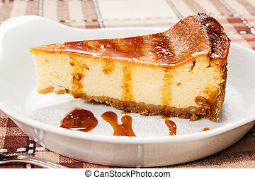 cheesecake with caramel sauce on the table