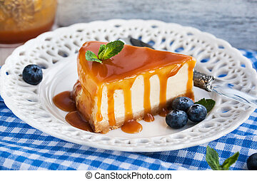 Piece of delicious cheesecake with caramel sauce