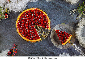 Cheesecake with cherry topping and christmas decoration. Top...