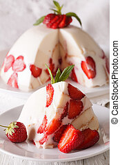 Cheesecake with strawberries and biscuit macro on a plate. vertical
