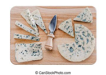 Cheeses on cutiing board
