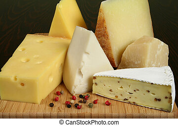 Cheeses - Variety of cheese: camembert, gouda, brie with...