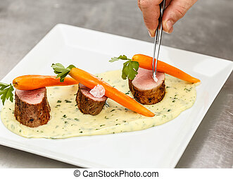 Chef adding finishing touch on his dish
