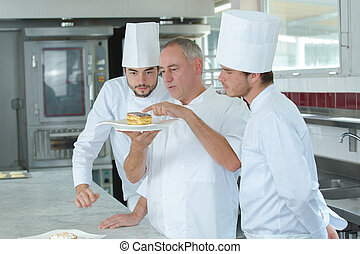 Chef advising apprentices