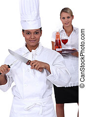 chef and waitress posing together