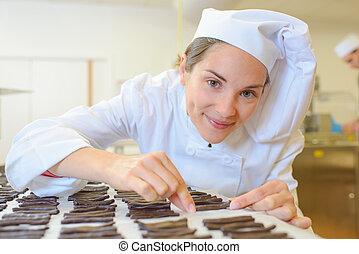 Chef arranging chocolates