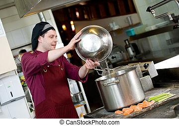 chef at work in kitchen
