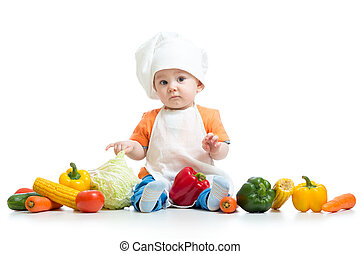 Chef child boy with vegetables isolated on white background