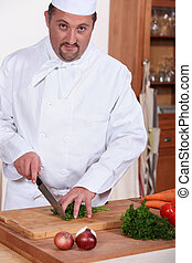 chef chopping herbs