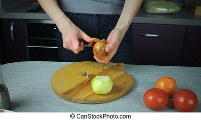 Chef clean onion onion on a wooden board - Girl chef clean...