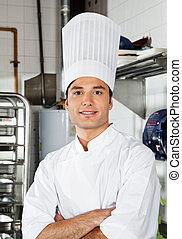 chef, cocina, cruzado, joven, brazos