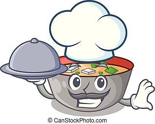 chef, con, alimento, sopa miso, tazón, en, tabla, carácter