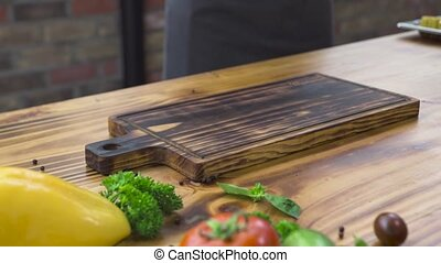 Chef cook putting on wooden table barbecue meat steak. Grilled steak with on wooden board. Food background on wooden copy space. Healthy nutrition and diet concept.