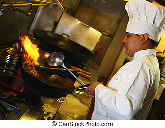 chef cooking looking from side