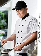 Chef cooking in a commercial kitchen