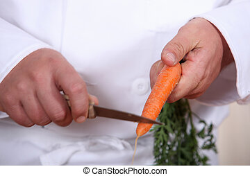 Chef cutting a carrot