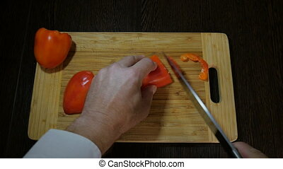 Chef cutting bell pepper salad