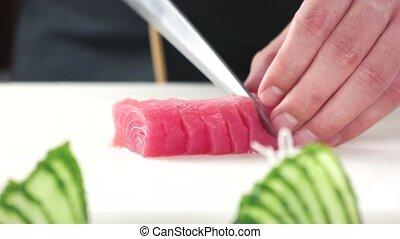 Chef cutting fish close up.