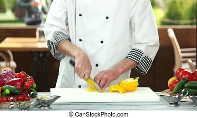 Chef cutting fresh vegetable.