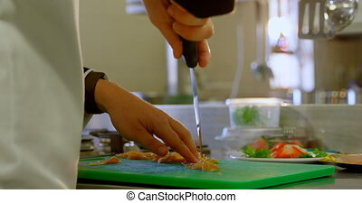 Chef cutting meat on chopping board in kitchen 4k - Mid ...