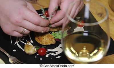 chef decorate chicken dish in restaurant