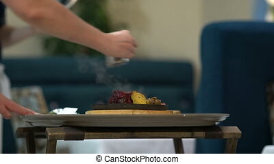 Chef doing flambe to food in pan with alcohol in big flame